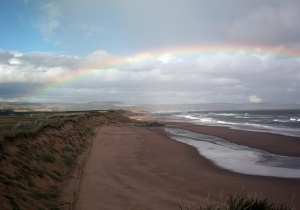 The long stretch of sand from the edge of the golf course looking towards St Cyrus